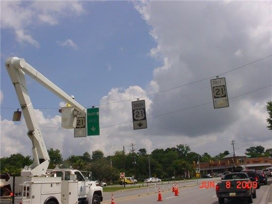 Traffic control truck fixing road sign